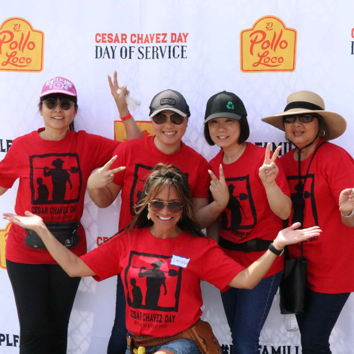 El Pollo Loco volunteer employees at an outdoor event.