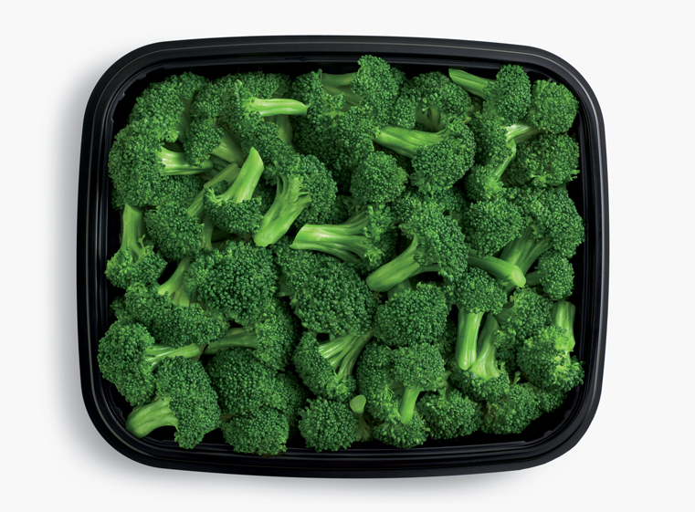 Open catering container of steamed broccoli