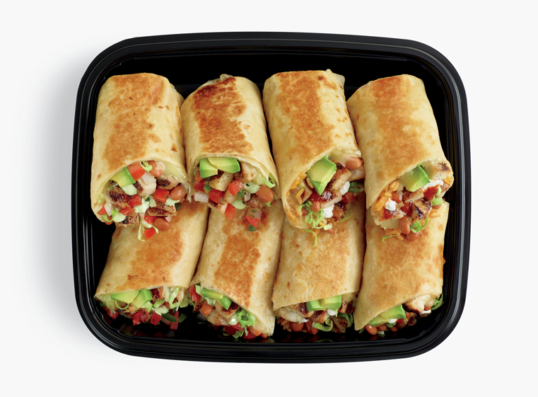 Open catering container of burrito halves