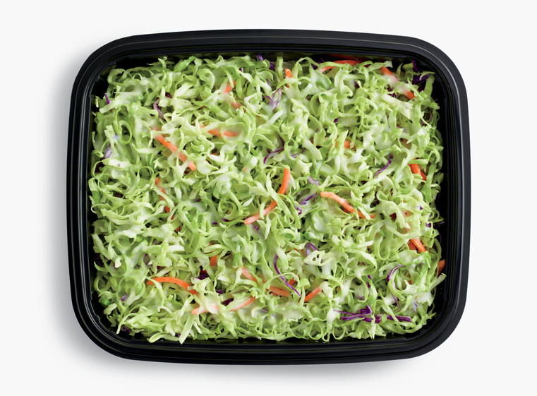 Open catering container of fresh coleslaw