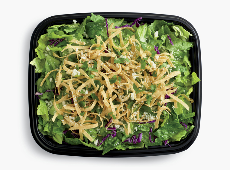 Open catering container of Loco Salad with tortilla strips