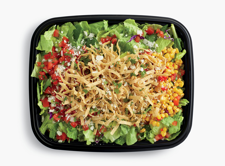 Open catering container of signature Mexican Salad