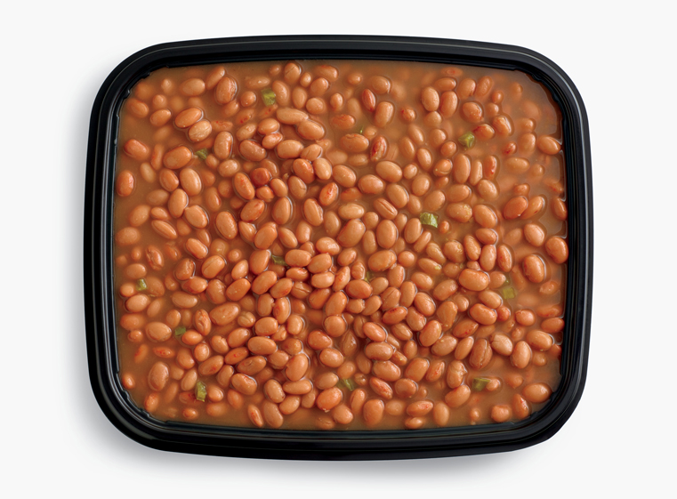 Open catering container of simmered pinto beans