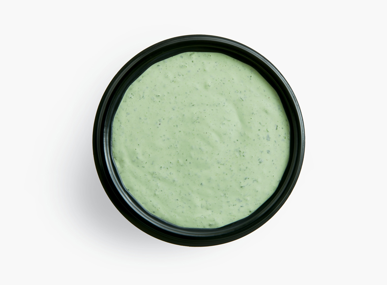 Side ramekin of creamy cilantro dressing