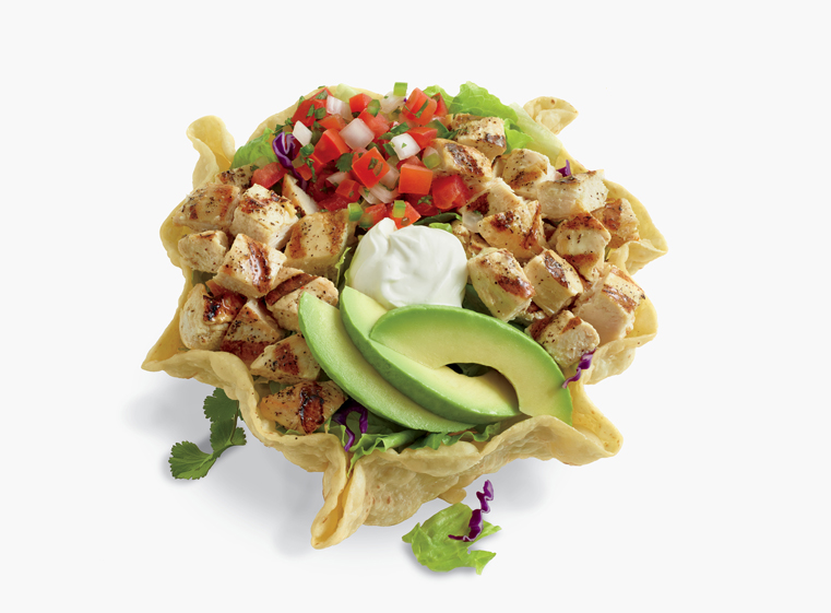 Double Chicken Tostada Salad in fried tostada shell topped with avocado