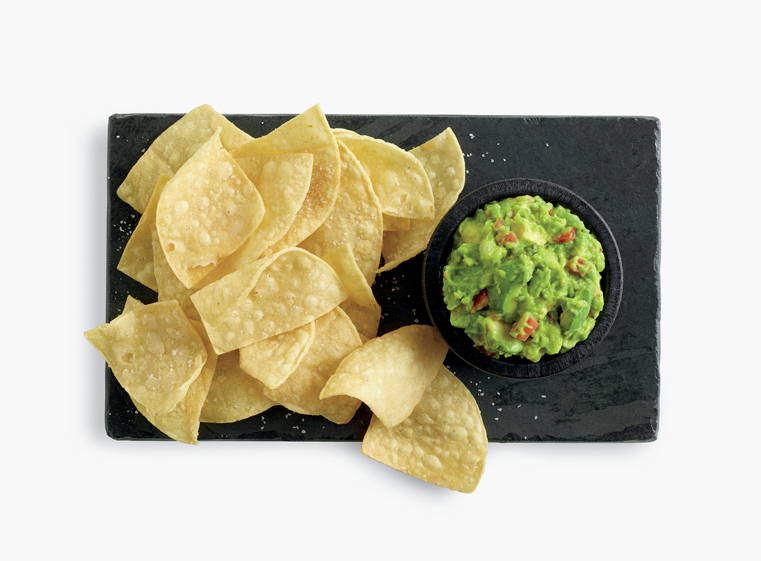 Tortilla chips with side of guacamole