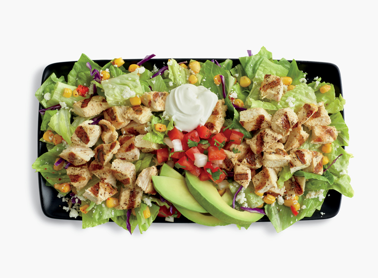 Double Chicken Avocado Salad topped with sour cream