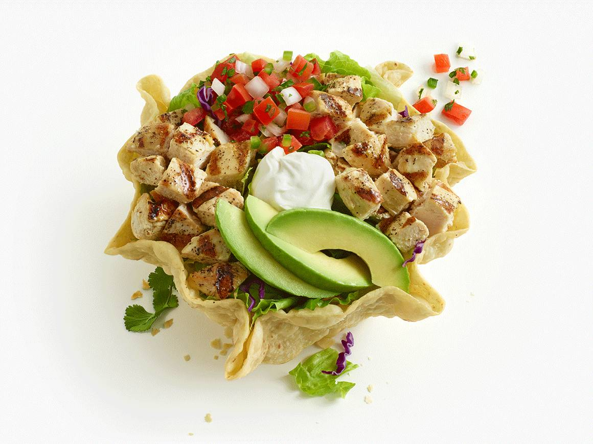 Double Chicken Tostada Salad in fried tostada shell