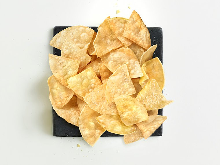 Tortilla chips served on plate